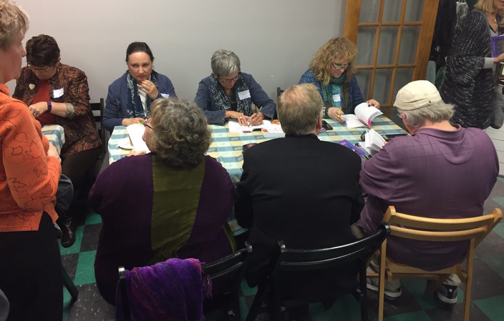 Several Beach Nights authors furiously signing books for loyal readers.